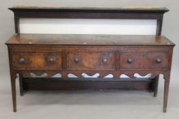 An 18th century oak dresser. 175 cm wide.
