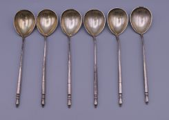 A set of six Russian silver niello teaspoons. Each 13 cm long.
