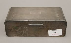 A silver cigarette box. 17 cm wide. 509 grammes total weight.