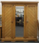 An Arts and Crafts inlaid ash triple wardrobe, en-suite (see also the following two lots).