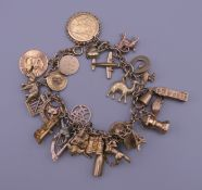 A 9 ct gold charm bracelet. 20 cm long. 52.5 grammes total weight.
