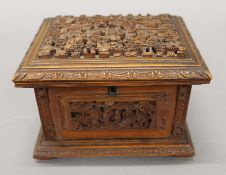 A late 19th century Canton carved wooden casket. 16.5 cm wide.
