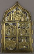 An 18th century Russian brass triptych of typical form with white and blue enamels, lacking sides.