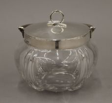 A silver mounted glass biscuit barrel. 13 cm wide.