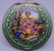 An Austrian silver and enamel compact. 7.5 cm diameter.