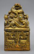 A large Chinese gilded bronze square seal with turquoise and red coral stones. 16.5 cm high.