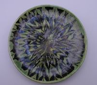 A small Chinese pottery green plate. 12 cm diameter.