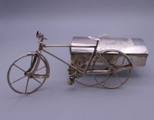 A 925 silver model of a bike and side car. 12.5 cm long.