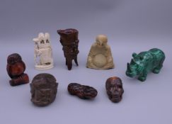 A quantity of various Chinese carvings. The rhino 11 cm long.