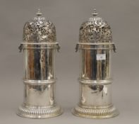A pair of large silver castors, each with expunged marks and re assay marks. Each 41 cm high. 128.