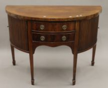 A George III mahogany demi lune sideboard. 137 cm wide.