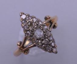 An 18 ct gold and diamond navette ring. Ring size N/O. 4.1 grammes total weight.