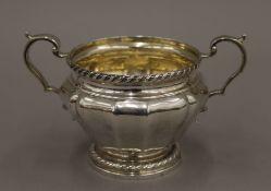 A twin handled silver sugar bowl. 16.5 cm wide. 11.5 troy ounces.