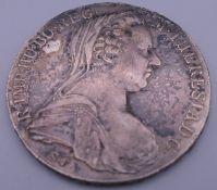 A silver Theresia coin.