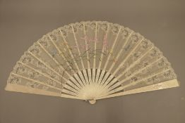 A 19th century bone, silk and lace fan painted with dragonflies and flora, in original box.