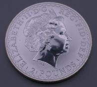 A 2000 fine silver Britannia coin.