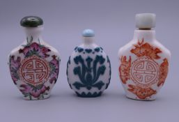 Three Chinese porcelain snuff bottles.