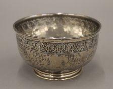 A Liberty and Co beaten silver bowl. 11.5 cm diameter. 7.4 troy ounces.