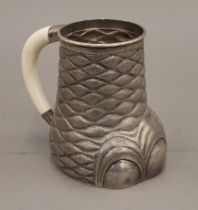 A late 19th/early 20th century Indian silver tankard formed as an elephant's foot with ivory handle.