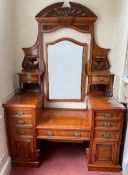 A Victorian carved burr oak dressing table. 146 cm wide.