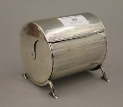 A cylindrical silver cigarette box. 9 cm wide. 10.1 troy ounces total weight.