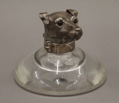 A Victorian silver mounted glass inkwell, the lid formed as a terrier's head. 11.5 cm high.