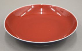 A Chinese porcelain blue and red ground dish, the underside with six character seal mark.