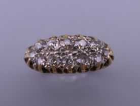 An 18 ct gold and diamond ring. Ring size O/P. 6 grammes total weight.