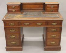 A Victorian walnut pedestal desk. 121 cm wide.