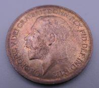 A 1919 half penny.