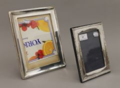 Two silver photograph frames. The largest 20 x 25 cm.