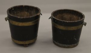A pair of early 20th century brass bound oak buckets. 30 cm wide.