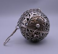 A Chinese silver travelling censer. 6 cm wide.