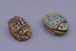 Two Egyptian scarabs. Each approximately 3.25 cm long.