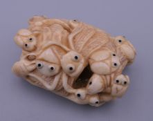 A carved bone netsuke formed as insects. 5 cm wide.