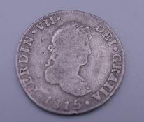 An 1815 silver Mexican coin.