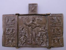 A small brass religious triptych. 6.5 cm high.