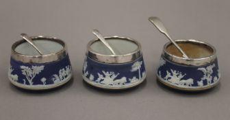 Three Wedgwood silver mounted salts. Each 6 cm diameter.
