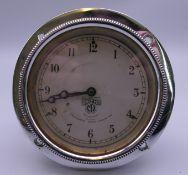 A vintage Smiths car clock with chrome surround. 10.5 cm diameter.
