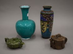 Two Oriental cloisonne vases and two Oriental teapots. The largest 24.5 cm high.