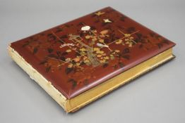 A late 19th/early 20th century Japanese lacquered photograph album. 35 cm wide.