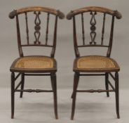 A pair of early 19th century faux rosewood cane seated chairs. 35.5 cm wide.