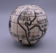 A bone globe compass. 7 cm high.