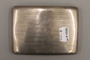 A silver cigarette case. 11.5 cm wide. 4.9 troy ounces.