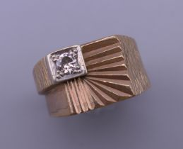 A 9 ct gold diamond set ring. Ring size P/Q. 8.4 grammes total weight.