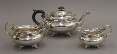 A silver three-piece tea set. The teapot 14.5 cm high. 43.6 troy ounces total weight.