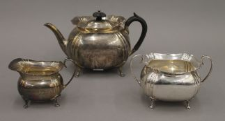 A silver three-piece tea set. The teapot 14 cm high. 18.9 troy ounces total weight.