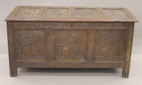 An 18th century oak carved three panel coffer. 134 cm long.