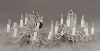 A pair of cut glass chandeliers. Each approximately 40 cm high.