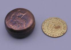 A half sovereign holder, made from bun head penny with a Hanover token.